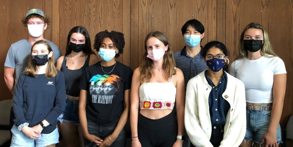 Class of 2022 and 2023 scholars posing with masks